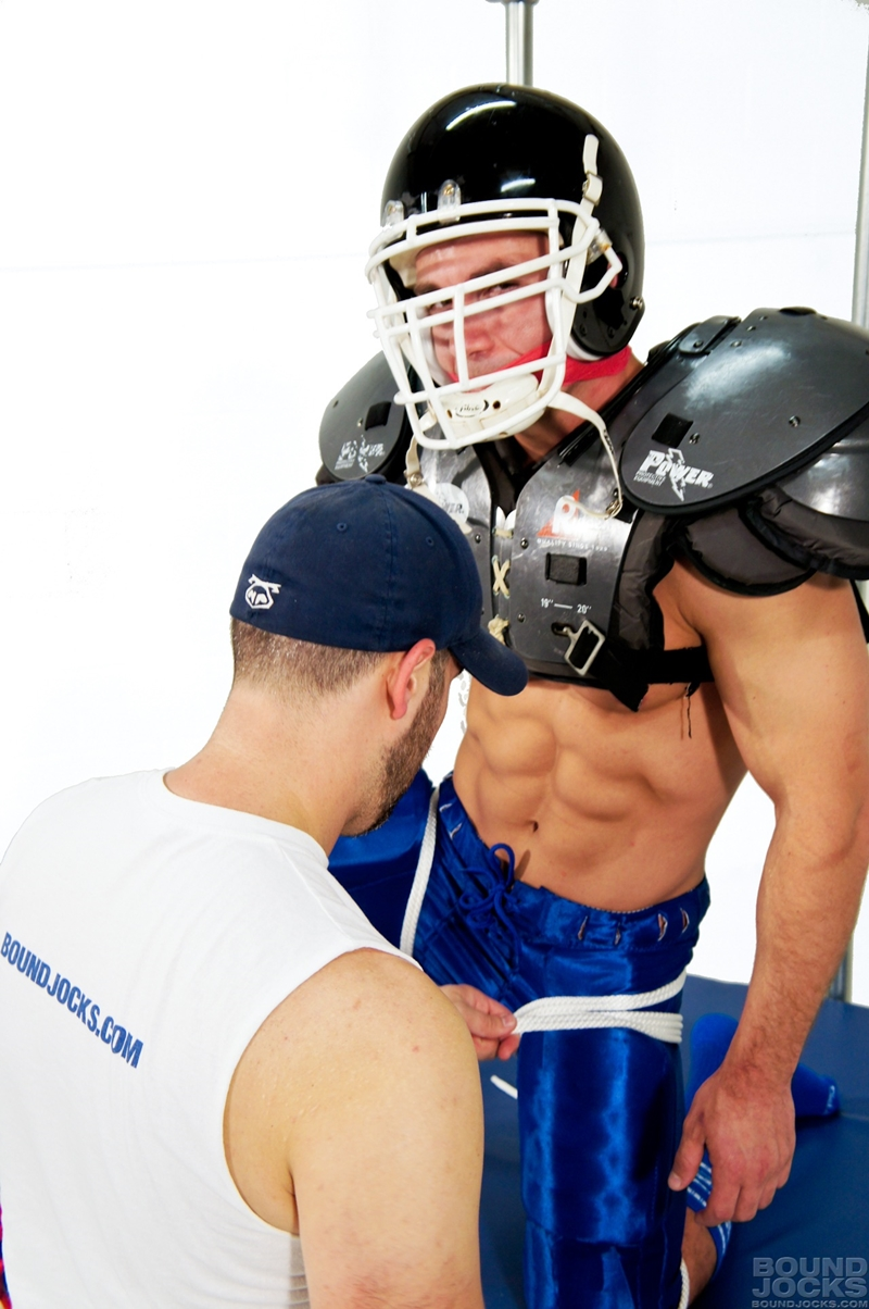 BoundJocks-Bound-gagged-muscle-jock-Marc-Dylan-football-uniform-hogtied-bdsm-Knotty-Brent-suck-giant-dick-blowjob-005-tube-video-gay-porn-gallery-sexpics-photo