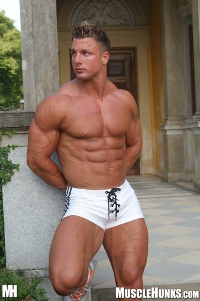 Hot blonde German big muscle bodybuilder Christian Engel stripped naked jerking his huge thick uncut dick