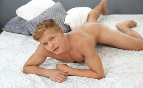 Sexy ripped blonde boy Axel Elbe drops his shorts exposing his hairy crotch and soft uncut dick